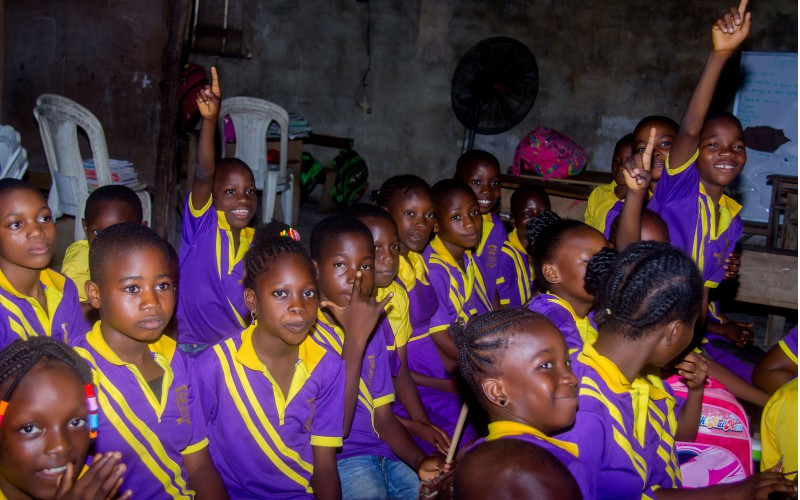 School children responding to questions during a career education CSR initiative